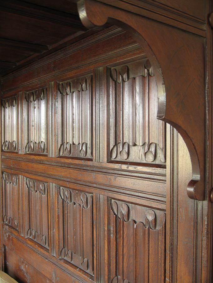 Linenfold panelled headboard for Replica furniture uk